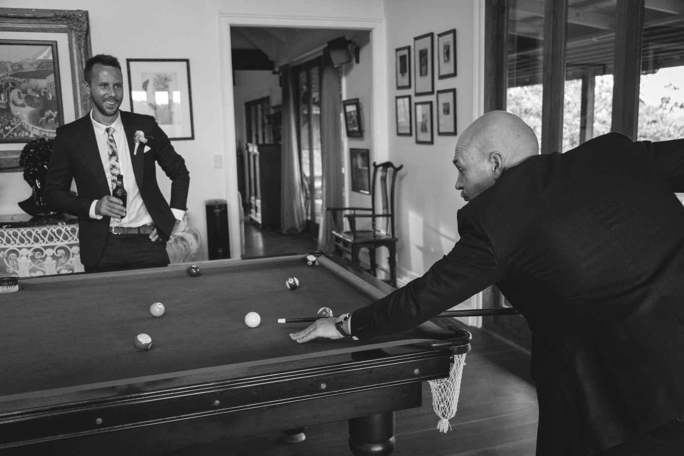 Al playing pool b+w