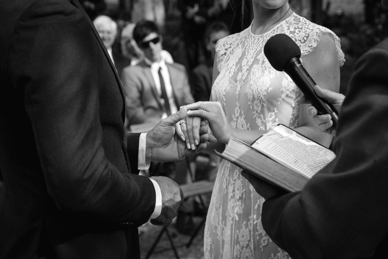Holding Hands after exchanging rings b + w