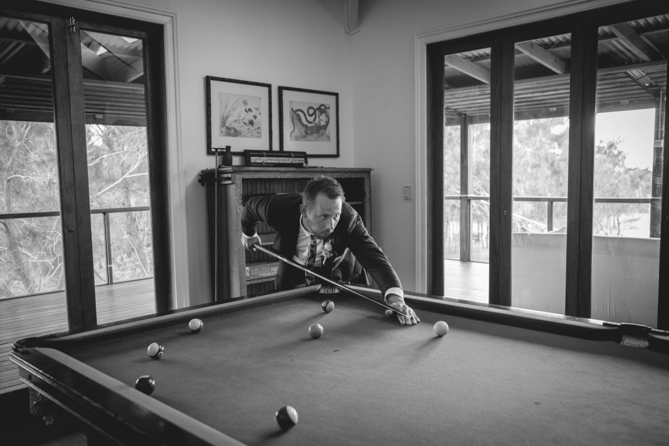 Pat playing pool b+w