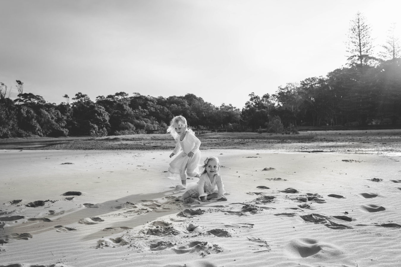 Girls playing in sand BW
