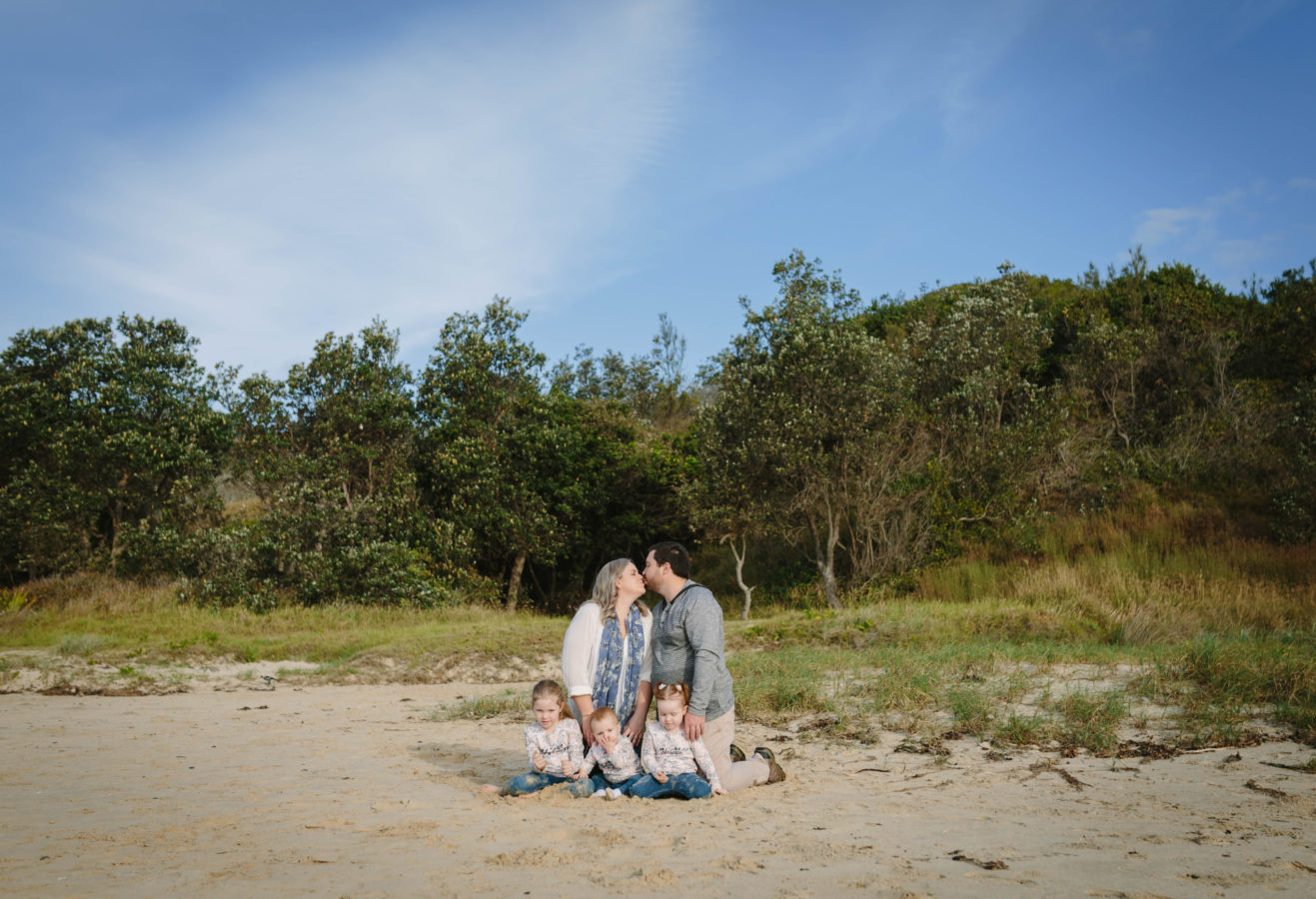 Family portrait beach kiss